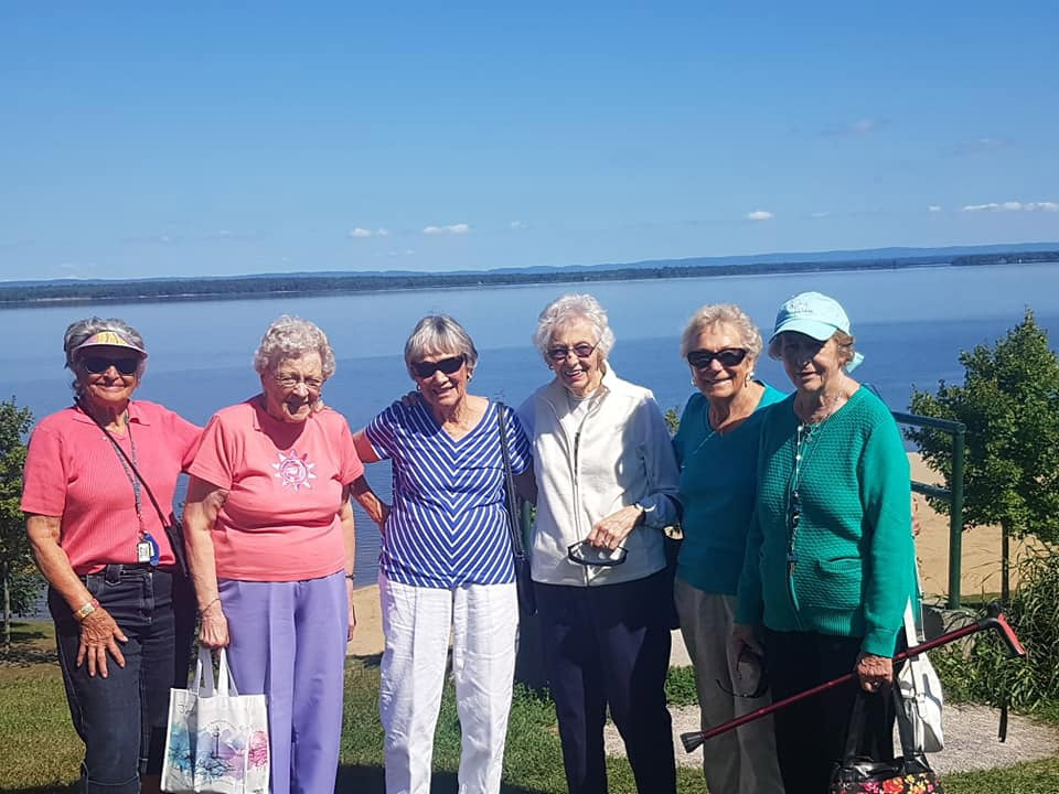 A group of women standng infront of a lake at a Carlingwood Retirement Community Event